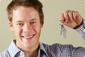 Young man holding keys